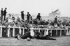 Emily Davison is struck by King George's horse, Anmer, and knocked unconscious. She died four days later from a fractured skull. 4 June 1913 (picture Hulton / Wikimedia Commons)