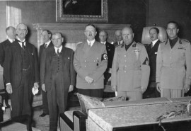 Chamberlani, Daladier, Hitler and Mussolini prepare to sign the Munich agreement (picture German Federal Archives)